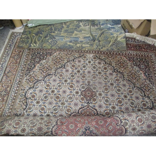34 - A large Indo-Persian carpet having multiguard borders and geometric designs, together with a wall ha...