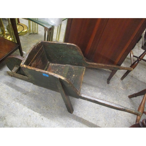 35 - An early 20th century green painted and polished pine child's wheelbarrow Location: BWR...