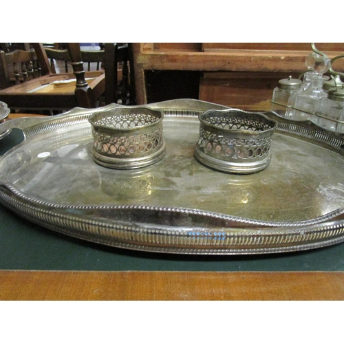 36 - A selection of silver plated items to include two galleried trays, a pair of wine coasters, a Victor...