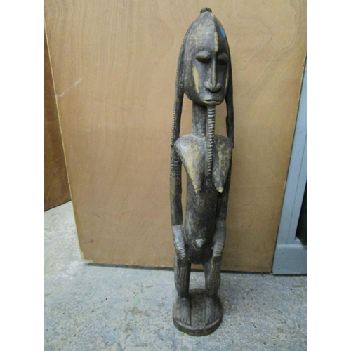 38 - An African carved wooden tribal art figurine 34