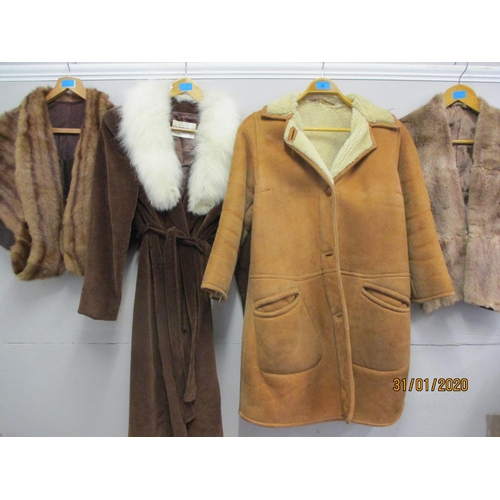 58 - Two vintage fur stoles, a 1970s Mornessa brown cord ladies coat with artic fur shawl collar and a De...