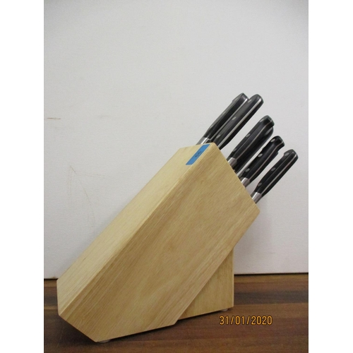 66 - A Sabatier nine piece knife block set including seven knives, a carving knife and a steel sharpener ...