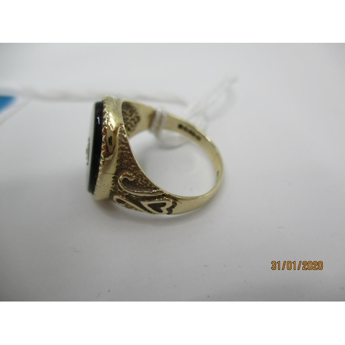 70 - A 9ct gold signet ring set with a black tablet and diamond, 4.3g Location: CAB...