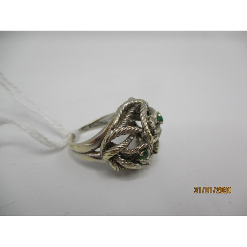 74 - A 9ct white gold irregular shaped ring set with white and green stones, 6.4g Location: CAB...
