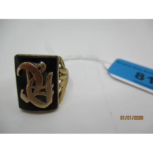 81 - A 9ct gold signet ring with a black tablet and initials, 6.95g Location: CAB...