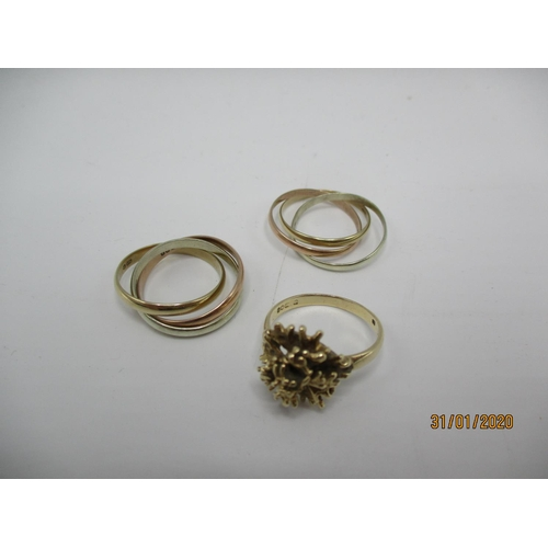 82 - Two 9ct gold Russian tri-coloured rings and a 9ct gold flower design ring Location: CAB...