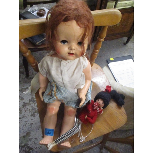 93 - A Pedigree doll with weighted eyes and a painted wooden doll Location: 9:2...