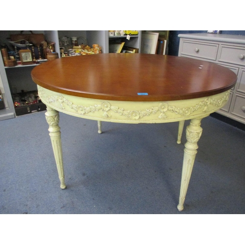 50 - A circular hardwood dining table of French style, turned, tapered fluted legs and matching upholster...
