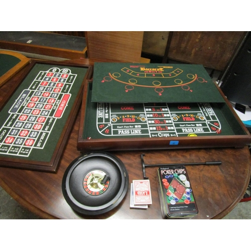 41 - A gaming box with roulette wheel, counters and other items Location: G...