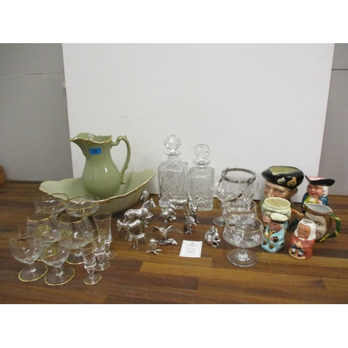 64 - Ceramics and glassware to include Toby jugs, decanters, a wash jug and bowl, along with Royal Hampsh...