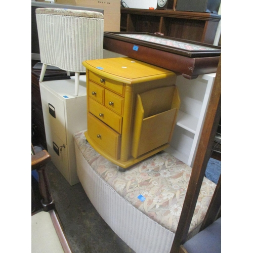 91 - A Lloyd Loom linen basket/stool, a matching ottoman and a modern five drawer chest with magazine hol...