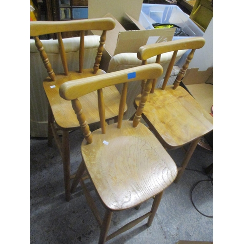 32 - Mixed chairs to include six spindle back dining chairs and four beech and elm high stools Location: ...