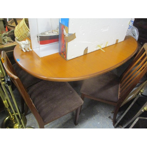 89 - A G Plan teak extending dining table and a matching set of four lathe back chairs, 28