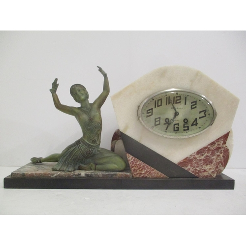 116 - An Art Deco French marble mantle clock with two matching garnitures. The oval dial inscribed 'Bedu-B...