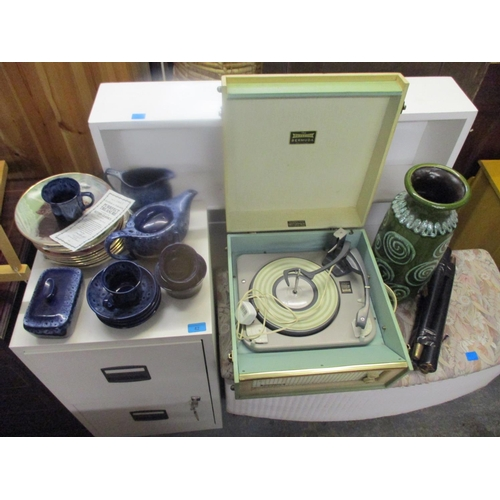 45 - A Dansette record player in a cream and green case, on legs, a West German vase, decorative plates a...