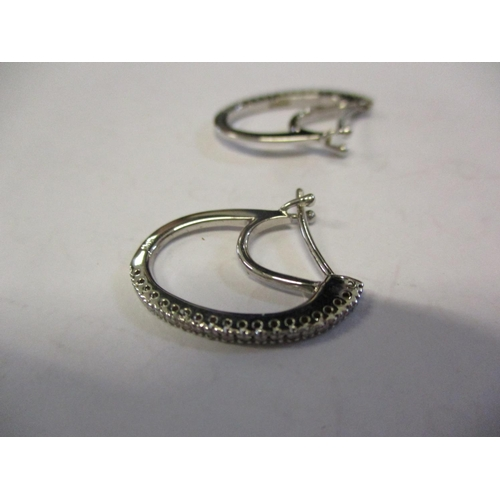 4 - A pair of 18ct white gold and diamond inset Tinton earrings Location: CAB...