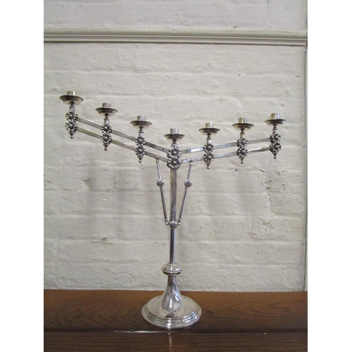 112 - A silver plated Ecclesiastical style candelabra with unusual telescopic and cantilever action, stamp...