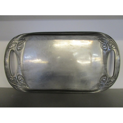 113 - Archibald Knox for Liberty, a Tudric pewter Art Nouveau tray, twin cut out handles, whiplash decorat...