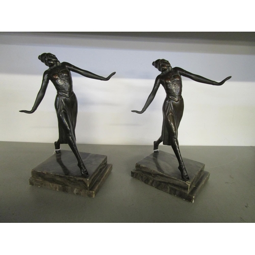 115 - A pair of Art Deco patinated, bronzed bookends, each of a young female dancer in typical pose, mount...