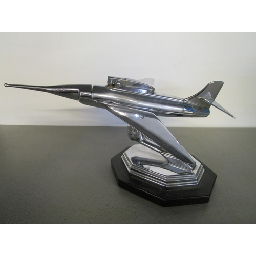 127 - A Gala Sonic mid 20th century table lighter, chrome plated in the form o f a jet fighter aeroplane, ...