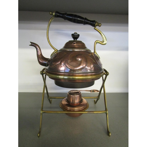 128 - A late 19th century/early 20th century Arts & Crafts copper and brass spirit kettle and stand in the...