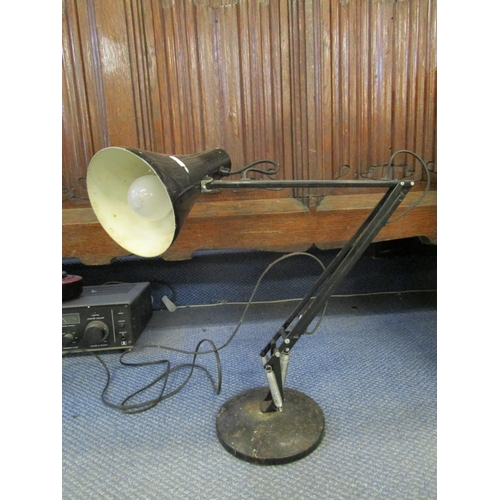 131 - Industrial design - a vintage anglepoise lamp in black, circa 1980 and a cased Singer sewing machine...