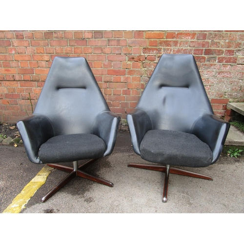 140 - Peter Hoyte - two swivel lounge armchairs in black vinyl, chrome and rosewood, circa 1960s, metal fa...
