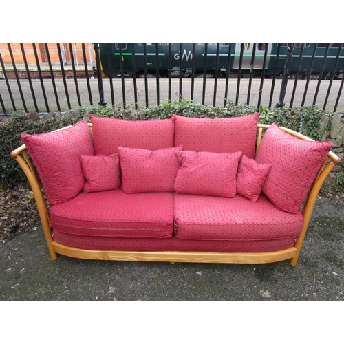 143 - An Ercol Renaissance low back, three seater sofa with loose cushions, circa 2000, Ercol label to one...
