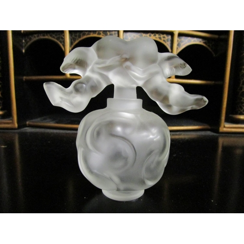 2 - A Lalique Falcon Nuages frosted glass scent bottle, the round bottle moulded with cloud motifs, the ...