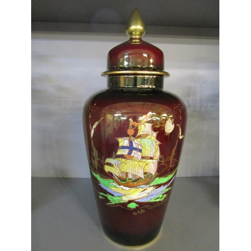 24 - D Cole for Crown Devon, Fieldings - a large lustre pottery temple vase and cover, decorated with a g...