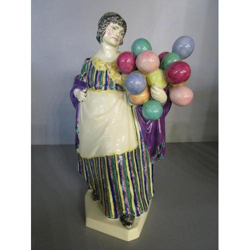 25 - Charles Vyse 1882-1971 a  Chelsea Pottery figurine of the Lady Balloon Seller, artist monogram and d...
