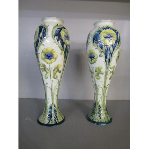 30 - William Moorcroft - a pair of Florian ware inverted baluster vases, tube lined decorated with tall f...