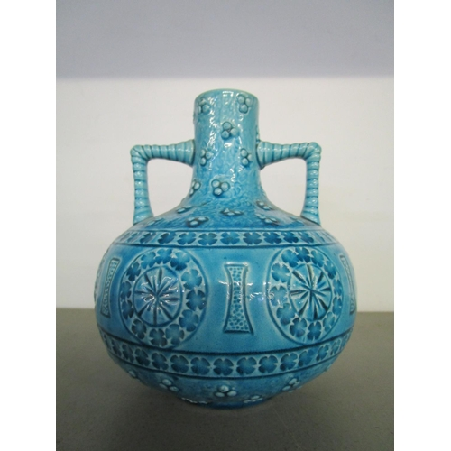 33 - A Burmantofts faience pottery, twin handled vase of compressed globular form with short narrow neck,...