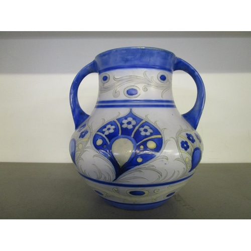34 - A William Moorcroft design for Moorcroft Pottery, a twin handled vase decorated in a Persian style f...