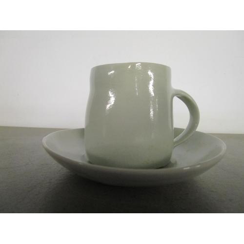 36 - Edmund de Waal (b 1964) - studio pottery - a pale Celadon cup and saucer, impressed potters seal mar...