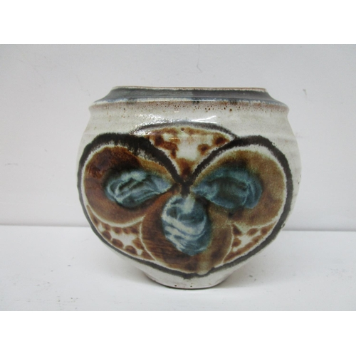 43 - An Aldermaston studio pottery vase of ovoid form, flower head design in blue and browns to front and...