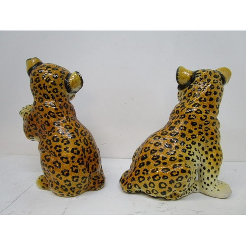 48 - Two Italian pottery, floor standing leopard/cheetah cubs, one signed indistinctly, the tallest 15 1/...