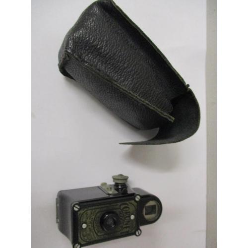 1 - A black cased Coronet midget camera in a black leather case Location: CAB...