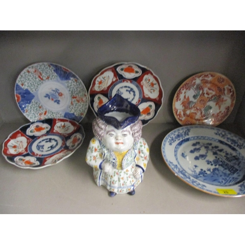 20 - Oriental ceramics to include a late 18th century Chinese blue and white plate and four Imari plates,...