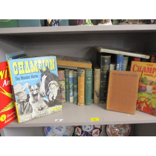 23 - A quantity of mainly mid 20th century books to include Champion the Wonder Horse and other annuals L...