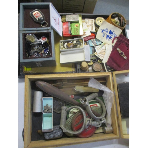36 - A mixed lot of collectables to include badges, buttons, silver charms, handcuffs and other items Loc...