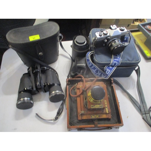 37 - Photographic related items to include a Praktica MTL 50 35mm camera, a Pentacon and other lenses and...
