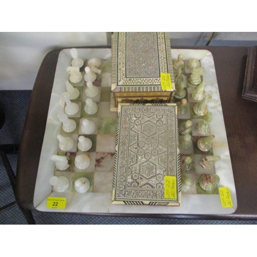 22 - An onyx chess set and board, two chess sets and two inlaid boxes Location: BWR...