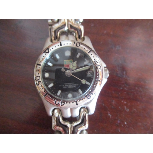 135 - A ladies watch in the style of a well known Swiss watchmaker Location: CAB...