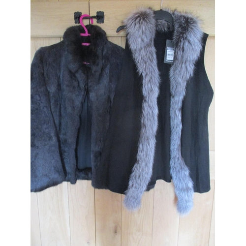 133 - A coney fur ladies jacket in black, together with a Jayley black suede, sleeveless jacket with wolf ...