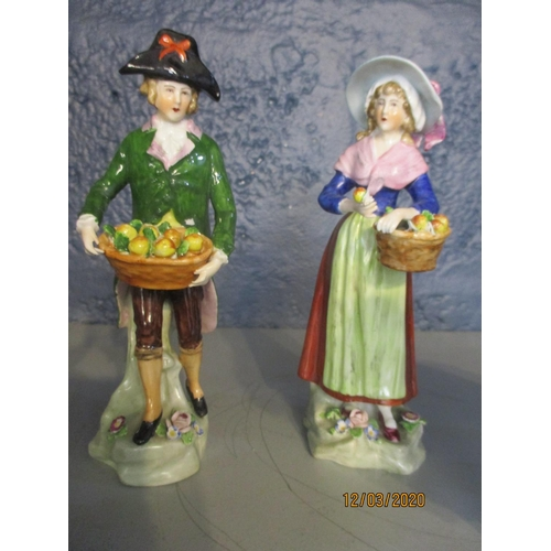 140 - A selection of miscellaneous ceramics to include a Staffordshire figure of a fruit seller and compan...