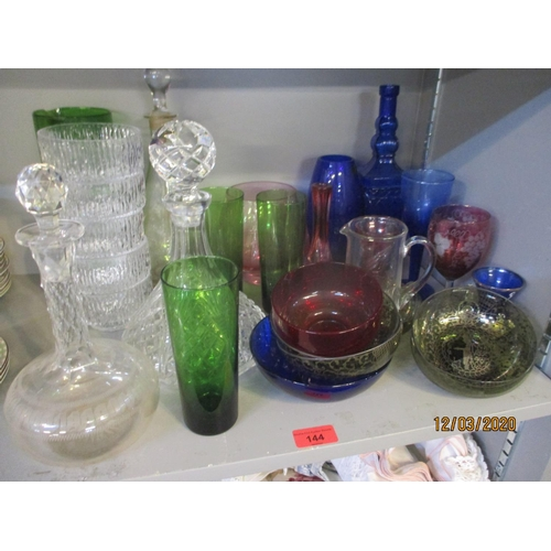 144 - A quantity of miscellaneous coloured glassware to include an Austrian wine glass, acid etched and cu...