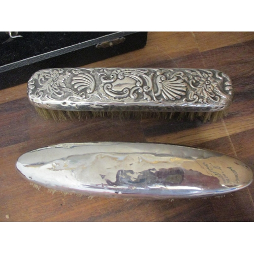 2 - A silver condiment set, boxed, together with two silver and white metal backed brushes Location: BR...