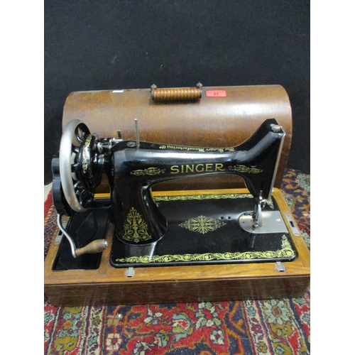 21 - A 1921 Singer sewing machine in oak case, serial number Y2275 735 Location: RWB...
