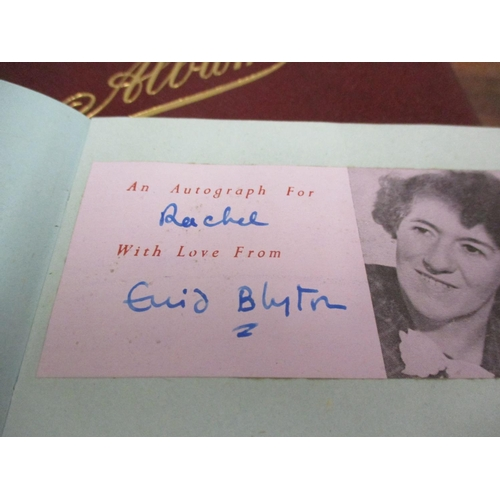 5 - An autograph book, mid 20th century containing Enid Blyton's signature and various Olympians, togeth...